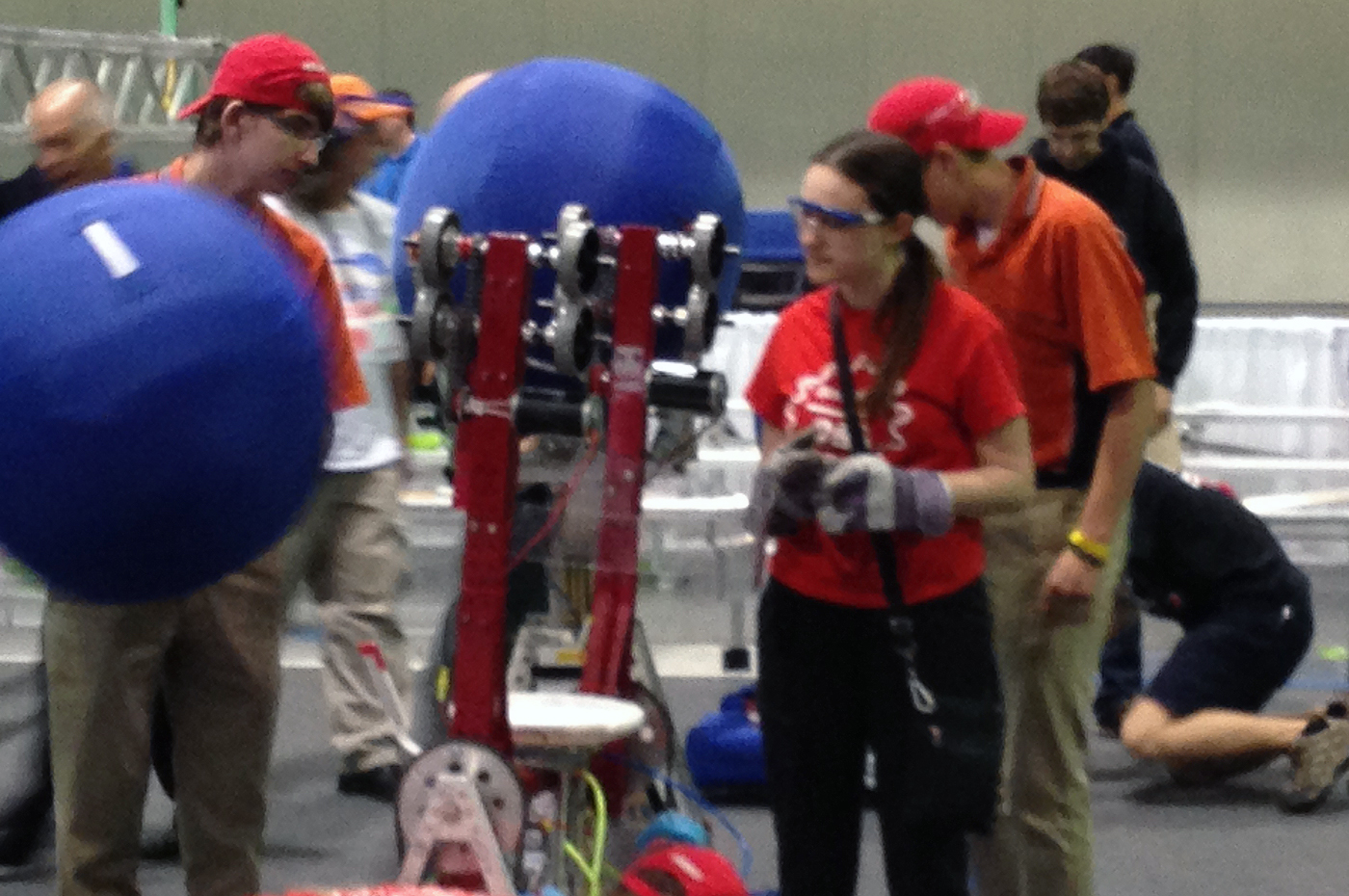 Teammates making last-minute adjustments to their robot.