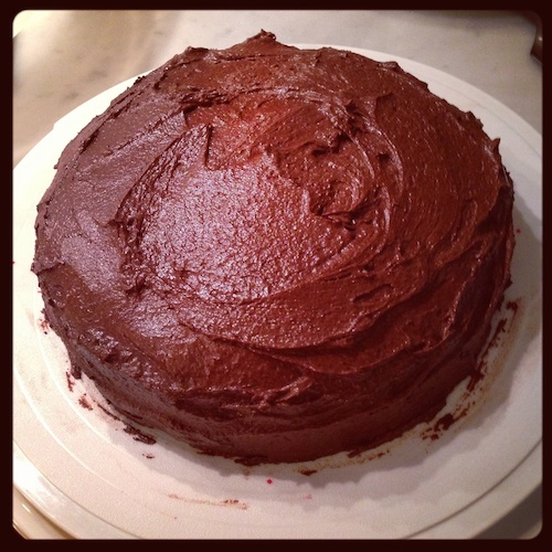 Round egg-less vegan chocolate cake.