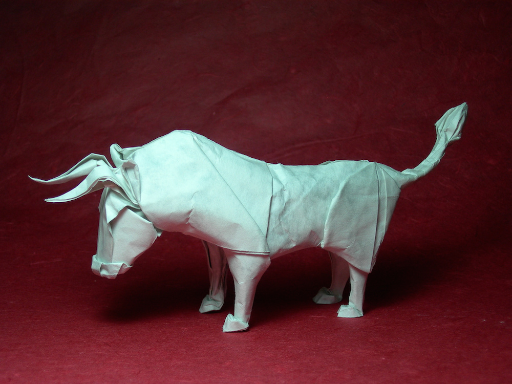 Photo of a wet-folded origami bull.