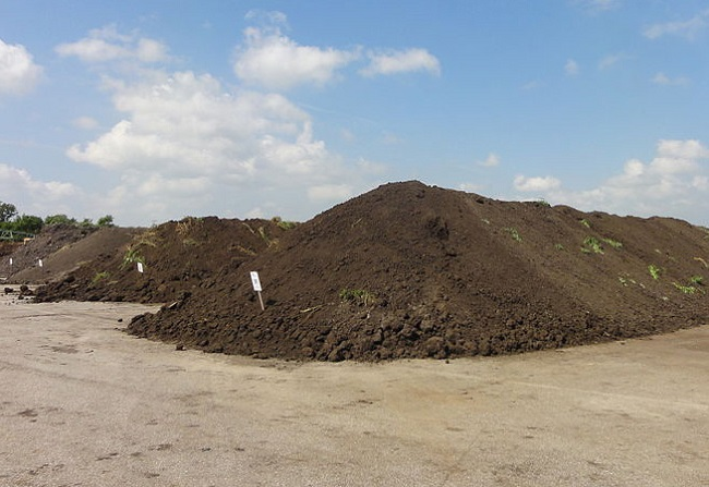 A photo of a commercial compost pile.