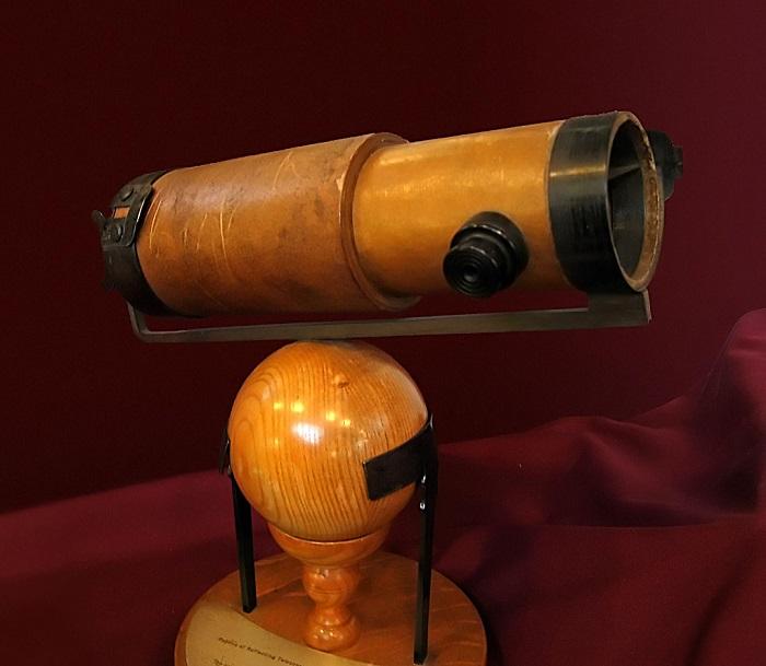 A Newtonian telescope replica.