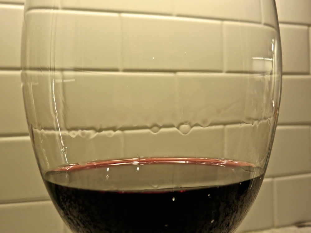 A glass with tears of wine caused by the Marangoni effect.