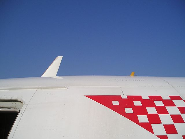 Photograph showing antennas on the fuselage of an airplane.