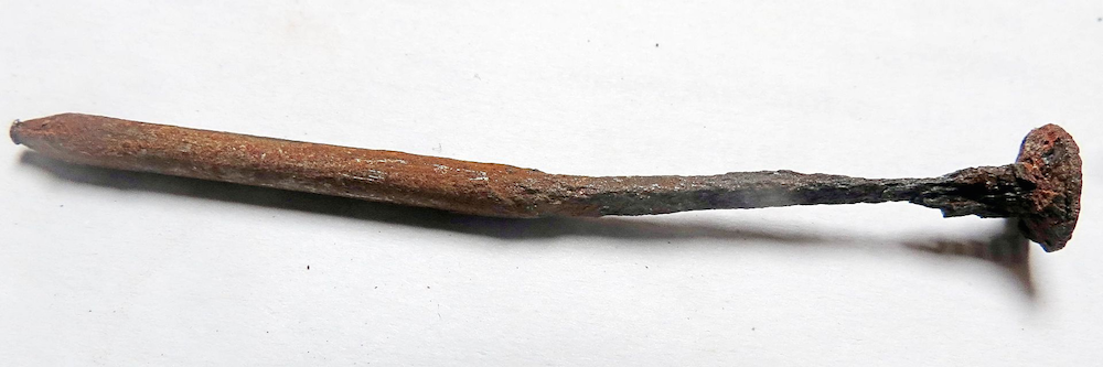 The results of atmospheric corrosion on a nail.