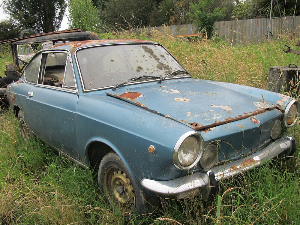 A photograph of a car dealing with the effects of corrosion.