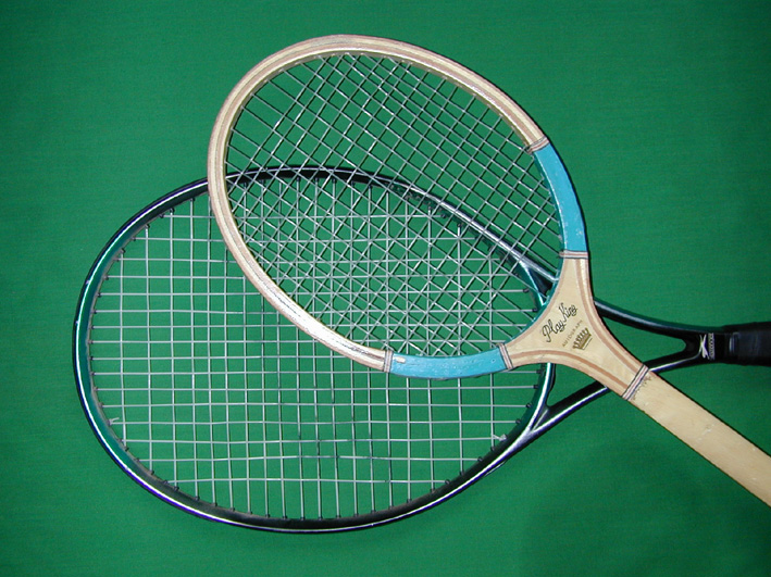 A photo illustrating design differences between old and new tennis rackets.