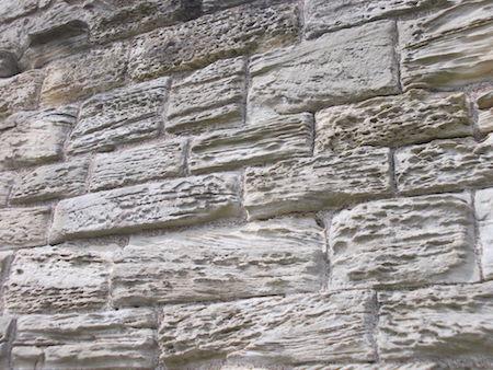 Salt damage to a brick wall featured