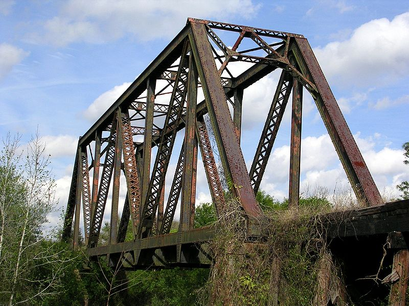 Photo of a warren-type truss bridge.