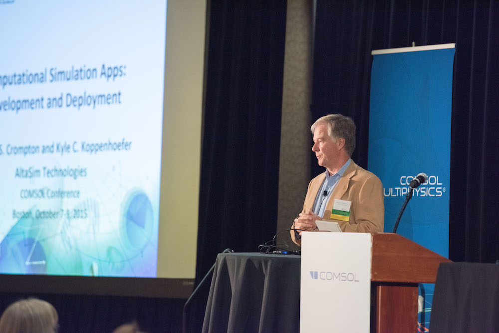 A photograph showing Jeff Crompton of AltaSim Technologies speaking at a past COMSOL Conference.