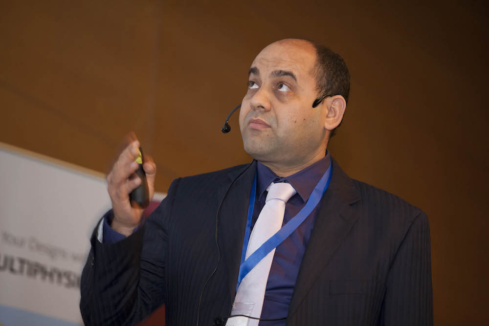 A photograph of Sadok Gaied presenting at the COMSOL Conference 2015 Grenoble.