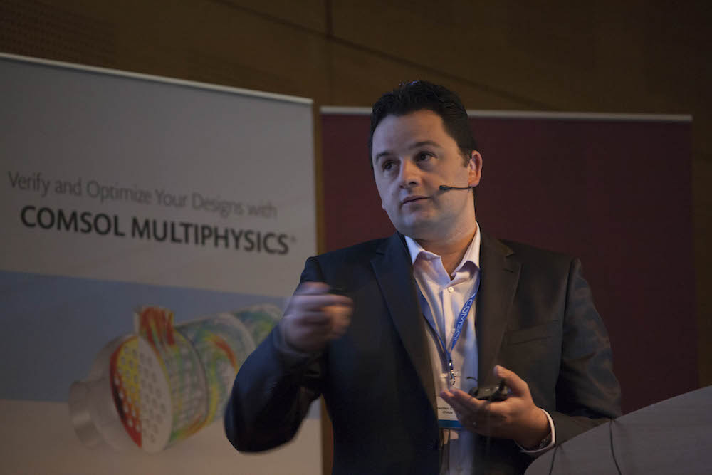 A photograph of Sébastien Cambon at the COMSOL Conference 2015 Grenoble.