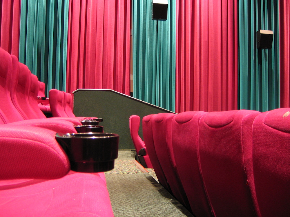 Image depicting loudspeakers in a movie theater.