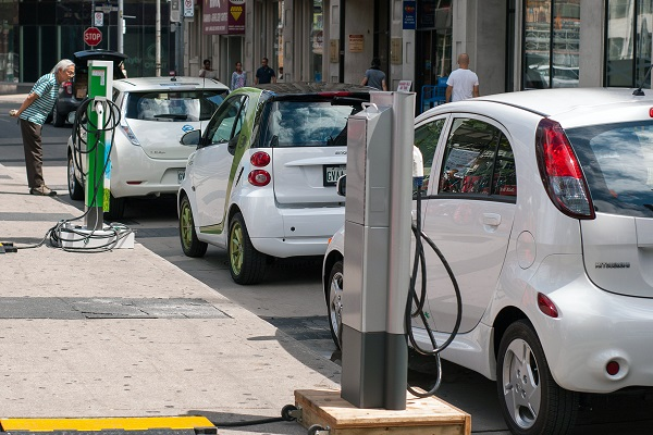 A photograph of a line of electric vehicles, which use permanent magnet motors to operate.