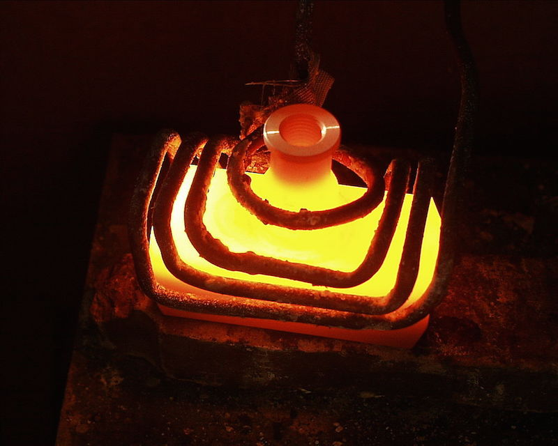 A photo depicting the process of induction heating.