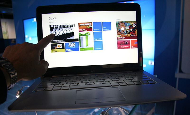 A photograph of a touchscreen laptop.