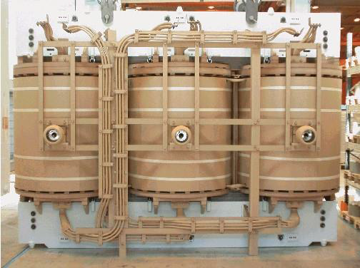 Photograph depicting a power transformer's active components.