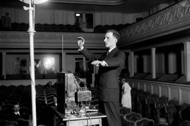 Photograph of Leon Theremin playing the theremin.