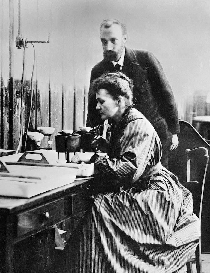Pierre and Marie Curie at work.