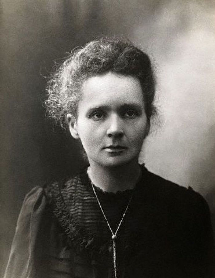 A photograph of Marie Curie.