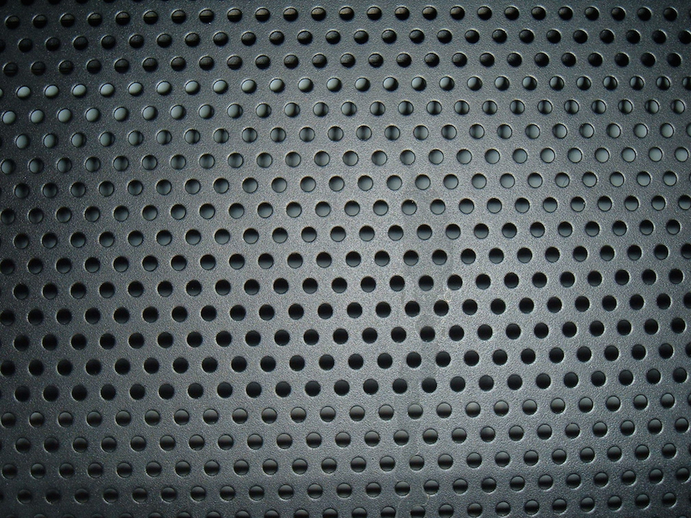 An image depicting perforations in steel.