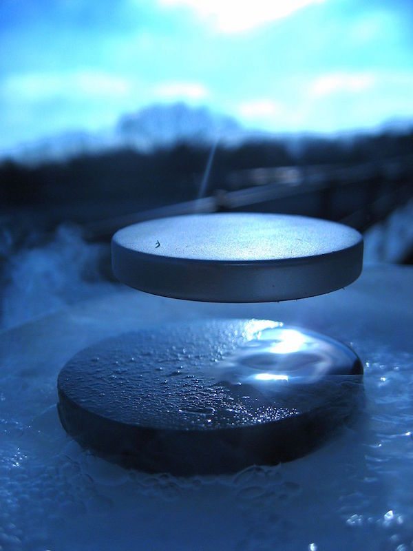 An image depicting a magnet levitating above a superconductor.
