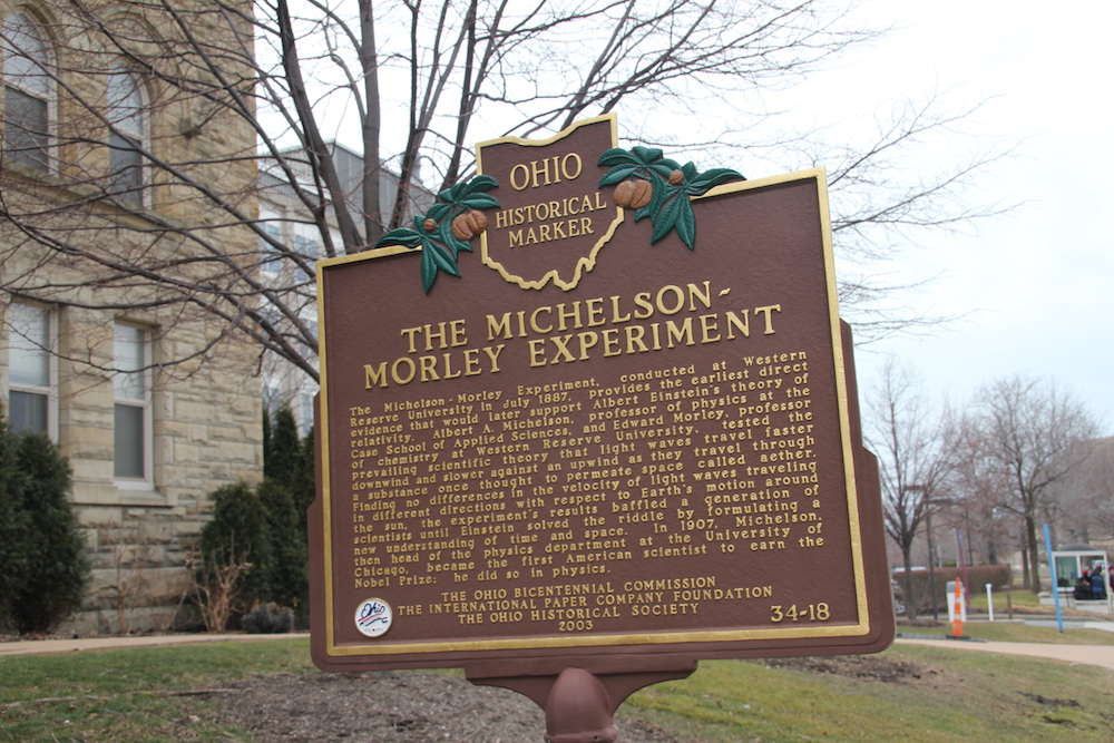 A photograph of a plaque commemorating the Michelson-Morley experiment location.
