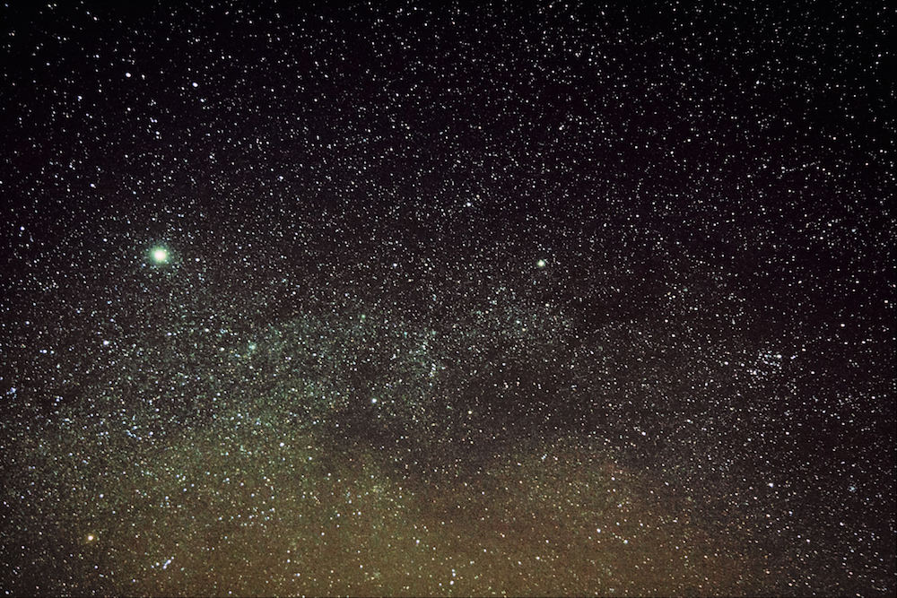 A photograph of stars in the sky, including Betelgeuse in the lower-left corner.