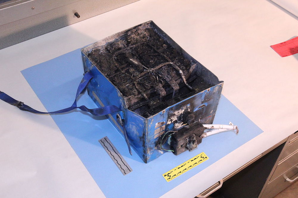 A photograph of a lithium-ion battery that caught fire.