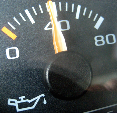 A photograph of a vehicle's oil gauge.