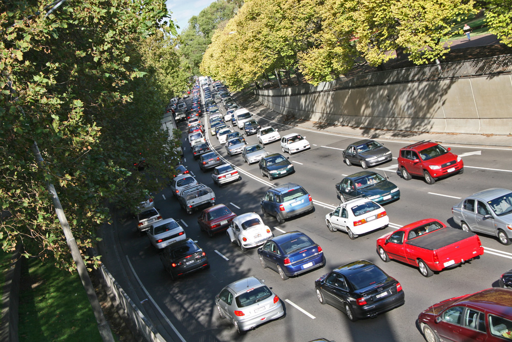 A photograph of vehicles in traffic on a road.