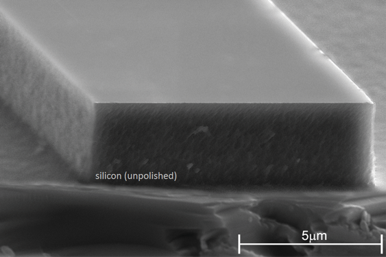 A scanning electron micrograph that shows an unpolished silicon-on-insulator rib waveguide used for magneto-optic routers.