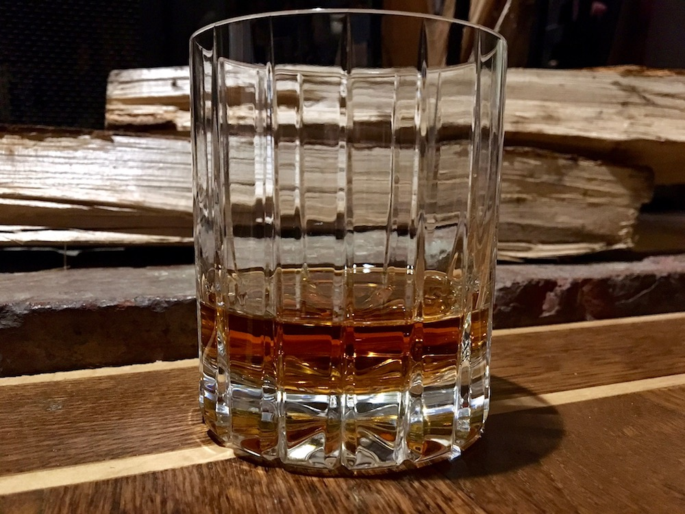 A photograph of a glass of whiskey.
