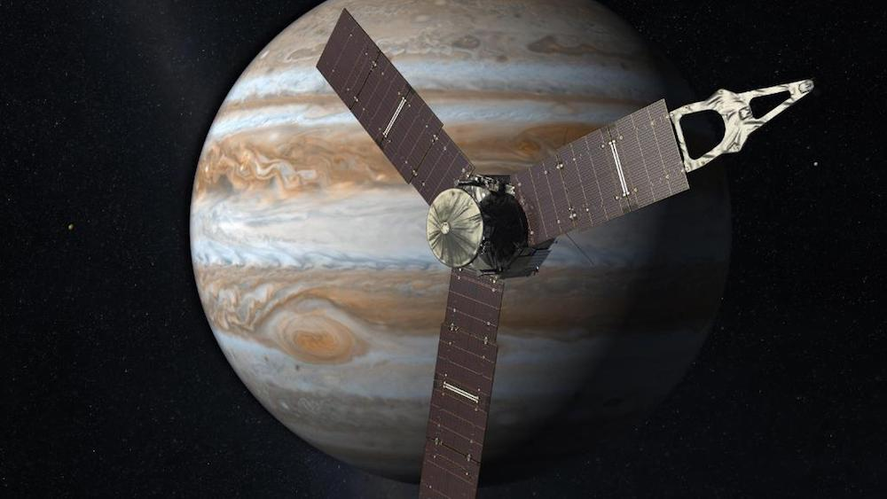 A photograph of the Juno spacecraft nearing Jupiter.