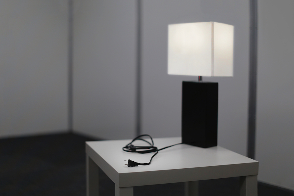 A photograph of a desk lamp in a QSCR room.