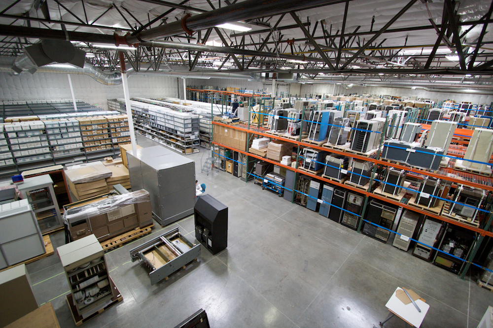 A photograph of a warehouse, which can benefit from wireless power transfer through QSCR.