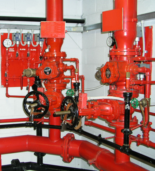 A photograph of a system of threaded pipes.