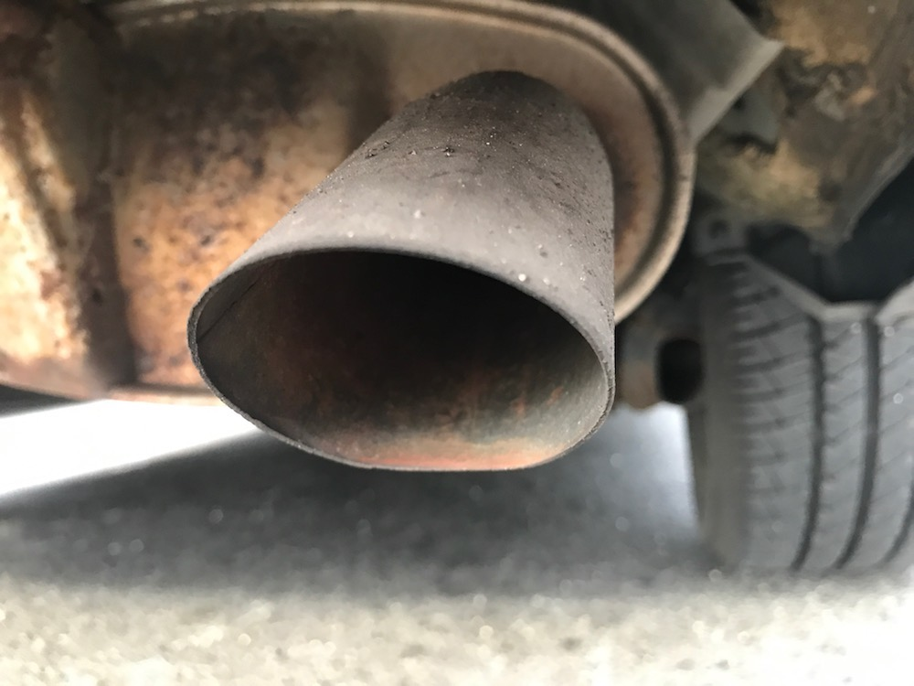 A picture of a rusted exhaust pipe.
