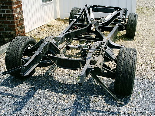A photo of a vehicle chassis with a suspension system.