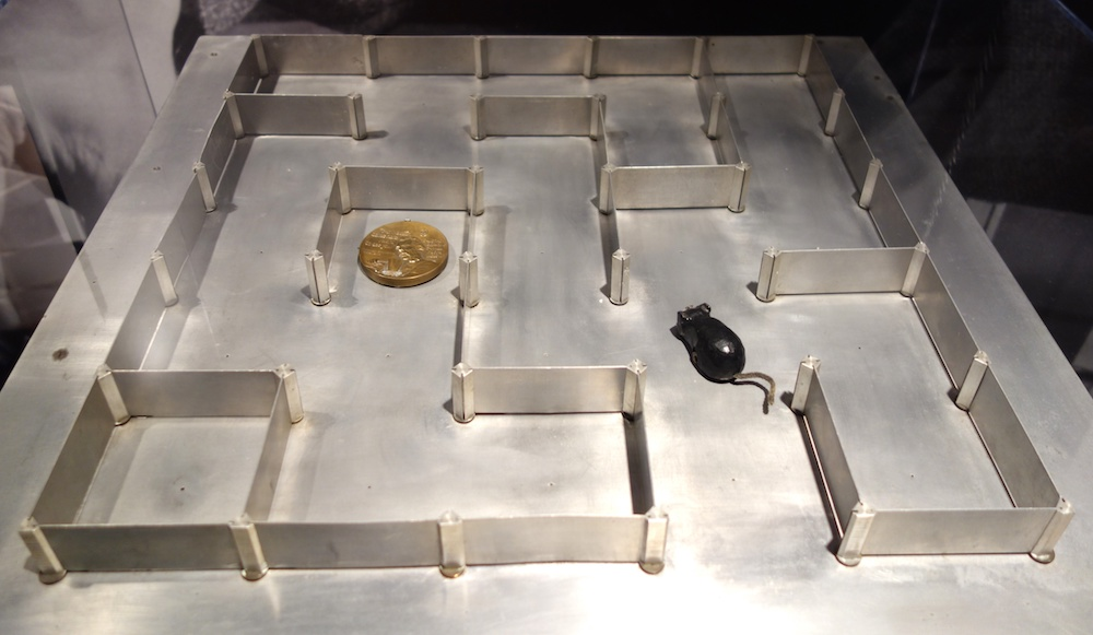 A photo of Shannon's maze with a magnetic mouse.