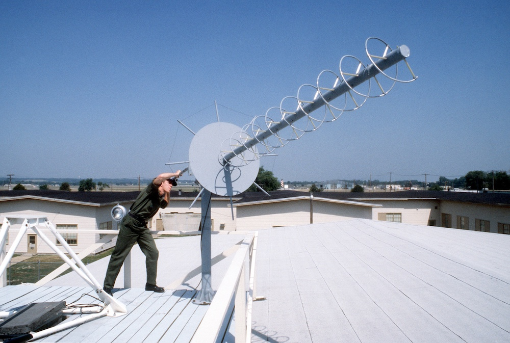 A photo of a helical antenna mounted to a roof.