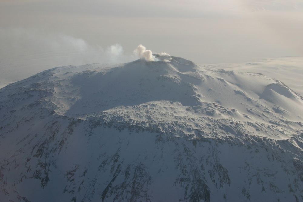 A photograph of Mount Erebus, an active volcano in Antarctica.