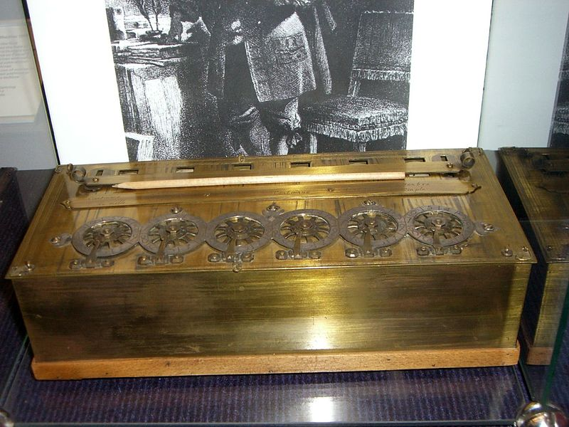 A photograph of a Pascaline, an early calculator device.