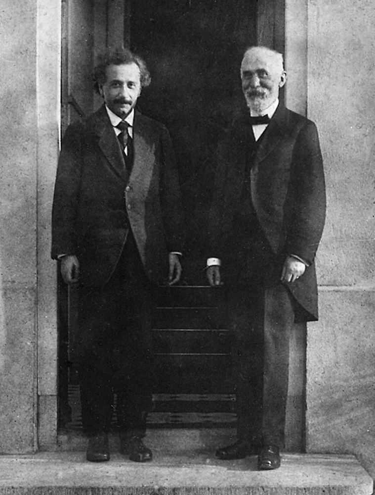 A black-and-white photo of Albert Einstein and Hendrik Lorentz.