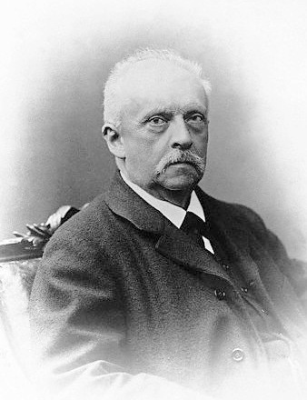 A portrait of Hermann von Helmholtz in black and white.