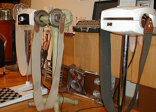 A photo of vibrating belts, exercise machines of yore.