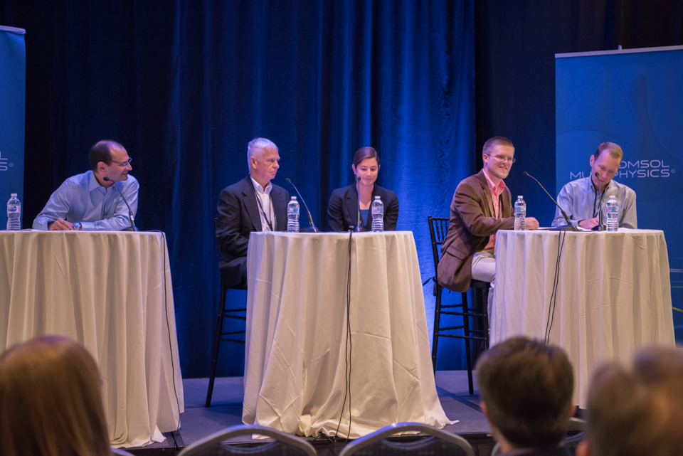 A photograph of a panel discussion at the COMSOL Conference.