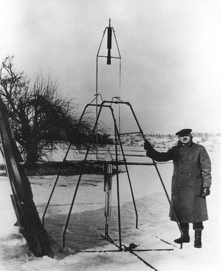 A photograph of Robert Hutchings Goddard standing at the site of his first rocket launch.