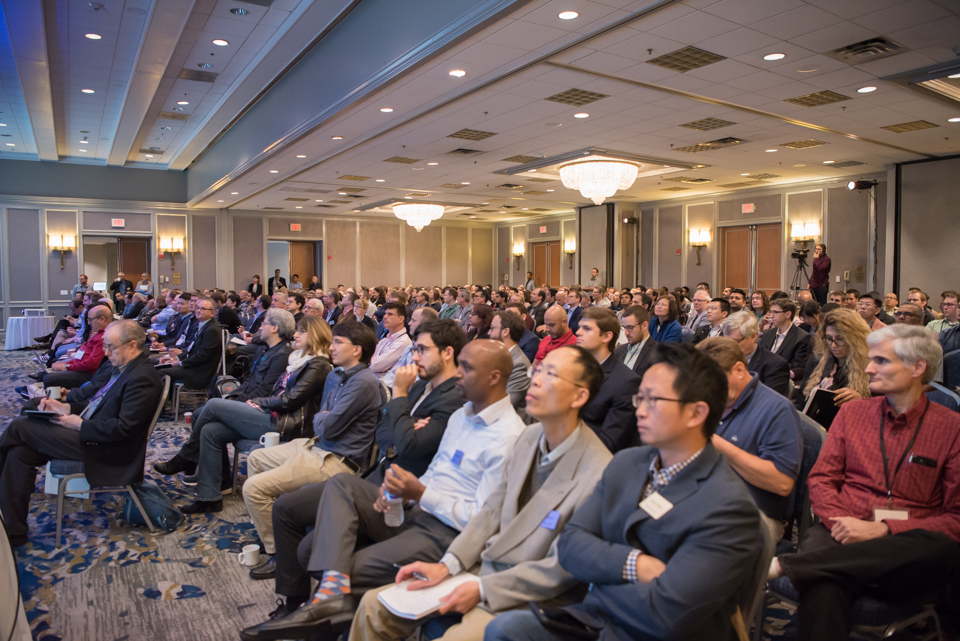 A photograph of COMSOL Conference 2018 Boston attendees watching a presentation.