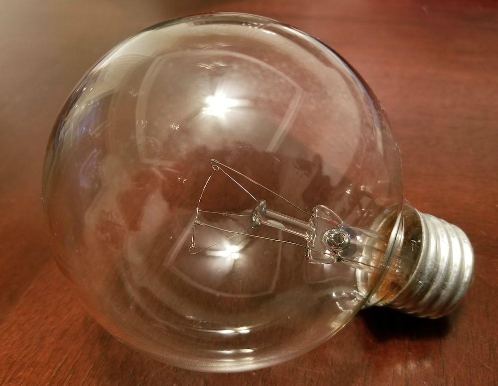 A photo of an incandescent light bulb with a ductile tungsten filament.