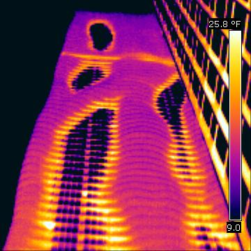 A thermal photograph of an insulated building envelope.